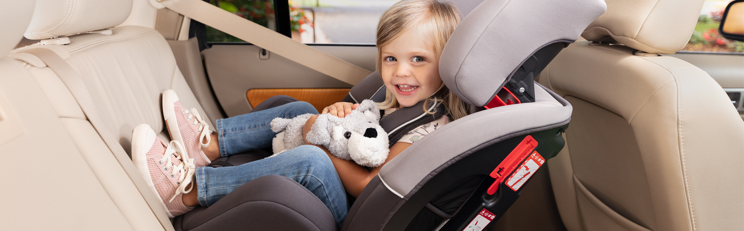 Turn2Me car seat with smiling baby looking at his mother.